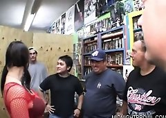 Big tit pornstar Whitney Stevens in an adult store giving the employes and chain fuck and suck