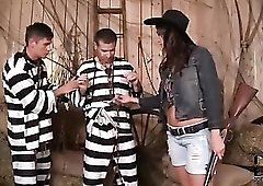 Cowgirl sucks big cocks of two prisoners