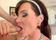 Busty MILF Lisa Ann satisfies a friend by sucking on his dick