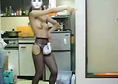 Japanese babe in mask is demonstrating her small tits