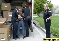 Slutty cops abusing arrested black stud in truck