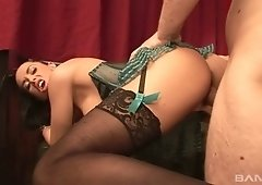 Nerdy sexpot in corset Sylvia greedily rides fat erected cock on top
