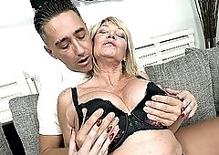 Busty mature granny Rosemary gets a huge cum shot on her tits