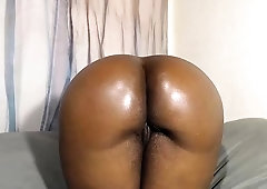 Big booty caramel babe in stockings worships a white cock