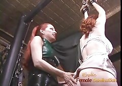 Latex-clad redhead wench has her way with a freckled ginger