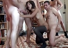 Sub brunette in submision group orgy with cumshots