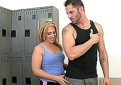 Mature blonde whore Stevie Lix deep throats in a locker room