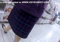 Cougar wearing a skirt has her white panties recorded