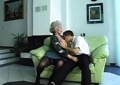 Big breasted blonde granny in stockings loves young meat