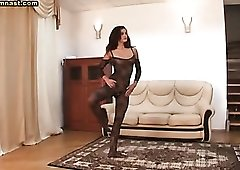 Flexible girl is sexy in black body stocking