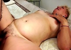 A fat lady that has a big ass is getting a dick in her mouth