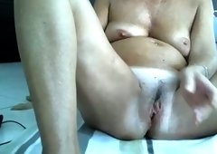 All naked ugly webcam nympho lazily pleases her own mature cunt