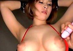 Horny babe Orihara Honoka jerks a dildo with her firm boobies