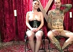 oluptuous domina is spanking and teasing him