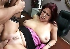 Fat redheaded bitch in a pink bra gets fucked on a desk