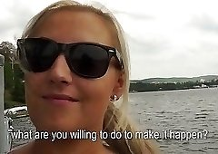 Blonde with shades enjoys her time on a boat