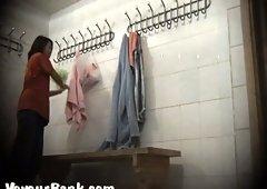 Cute brunette stranger girl in the locker room on hidden cam