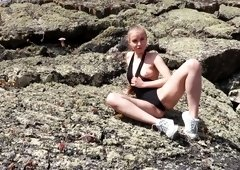 Sporty climber Angel B plays with her natural titties on the rocks