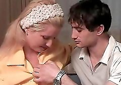 Horny mature woman does not mind being seduced by a hunk
