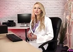 Bodacious nurse in stockings Amber Jayne is playing with a suction cup dildo