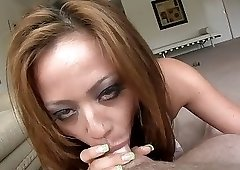 Grey makeup tanned slut sucking a massive cock