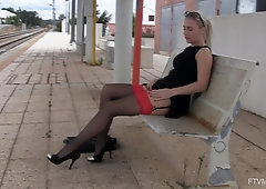 Amateur blonde babe Aston plays with her glasses and pussy in public