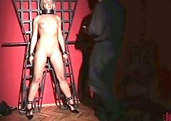 Sex-appeal belted babe is masturbating pussy in the basement