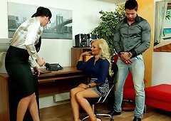 An eye catching brunette was distracted by her boy friend then spanked in the office.