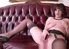 Big natural tits brunette masturbates in retro nylons garters high heels