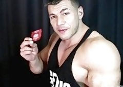 Hunk stripping jizzing in condom