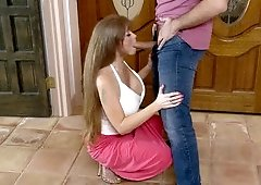 A blonde cougar is fooling around with a younger guy in the living room