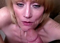 Mature blonde woman sucks an erected pleasure tool