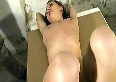 Tied girl experiences pain for her body