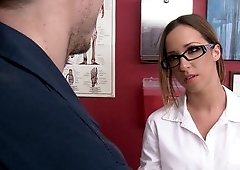A girl that has her glasses on is receiving dick in the exam room