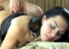 Dark-haired chick in pantyhose was pounded on the bed